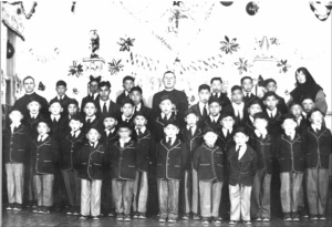 Local Input~ Photograph of a group of boys and staff St. Anne's Indian Residential School (Fort Albany, Ont.) originally created 1945 ---- Credit: Algoma University Archives
